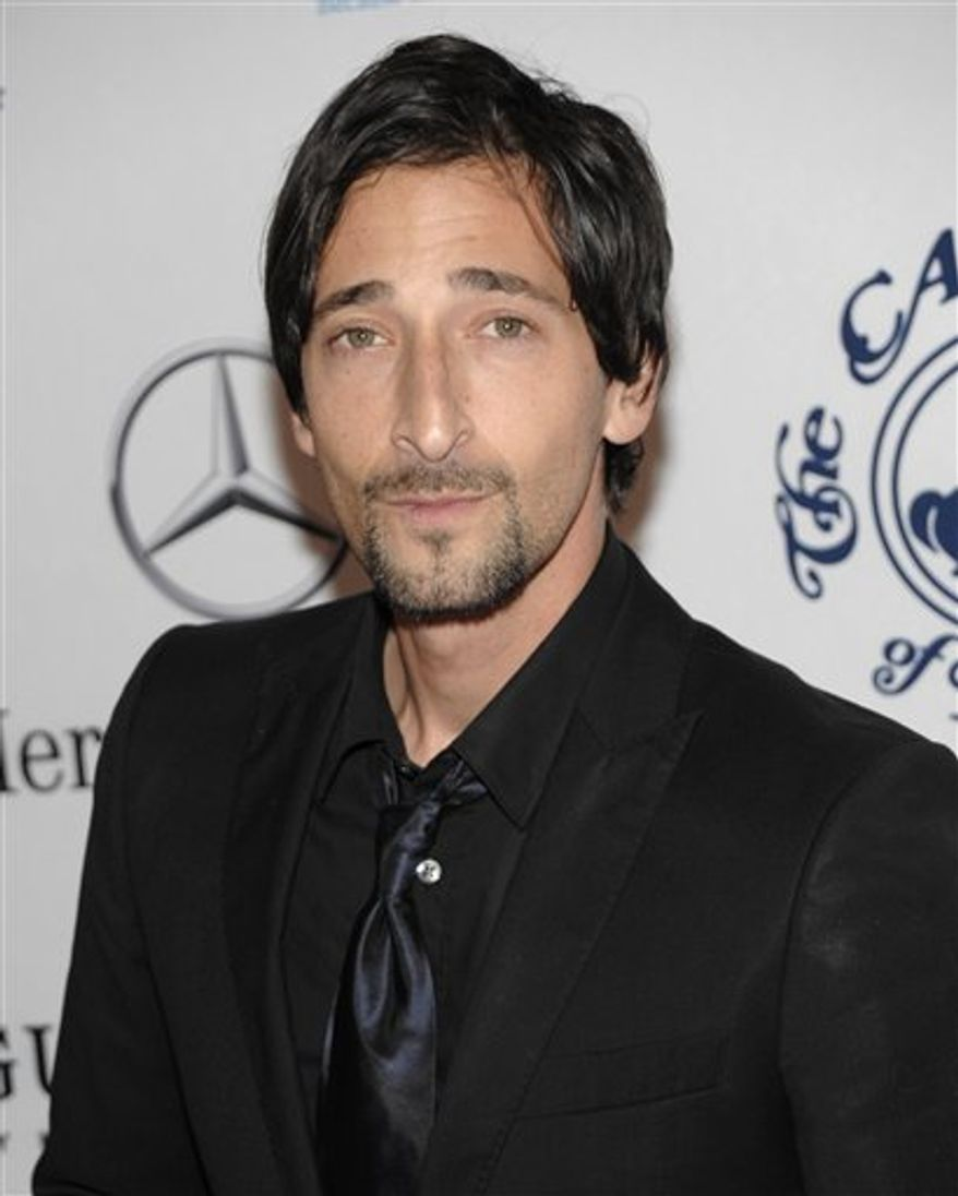 """FILE - In this Oct. 23, 2010 file photo, actor Adrien Brody arrives at the 32nd Annual Carousel of Hope Ball in Beverly Hills, Calif. A federal judge in Los Angeles has blocked the makers of a thriller film starring Adrien Brody from using the Oscar-winning actor's likeness until he is fully paid for his role.  U.S. District Judge Dale S. Fischer issued a ruling Monday, Nov. 22, 2010, blocking the makers of """"Giallo"""" from continuing to distribute, market or sell the film in the United States. (AP Photo/Dan Steinberg, file)"""