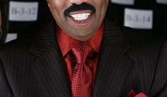 FILE - In this Sept. 12, 2009 file photo, Steve Harvey arrives for the Chado Ralph Rucci spring 2010 collection show during Fashion Week in New York.  (AP Photo/Jason DeCrow, file)