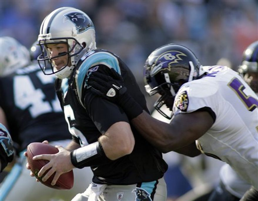 Baltimore Ravens' Ray Lewis high-steps into the end zone for a touchdown after an interception against the Carolina Panthers in the second half of the Ravens' 37-13 win in an NFL football game in Charlotte, N.C., Sunday, Nov. 21, 2010. (AP Photo/Chuck Burton)