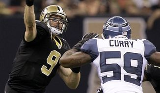 New Orleans Saints quarterback Drew Brees (9) passes  during an NFL football game against the Seattle Seahawks at the Louisiana Superdome in New Orleans, Sunday, Nov. 21, 2010. The Seahawks lost 34-19 to the Saints.(AP Photo/Bill Haber)