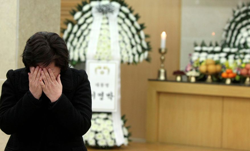 An unidentified relative of Seo Jeong-woo, a South Korean marine killed on Yeonpyeong Island by North Korea's artillery attack, weeps during a memorial service at a military hospital Wednesday. (Associated Press)