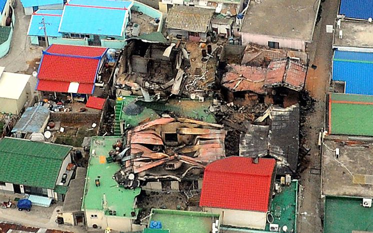 An aerial view shows destroyed houses on Yeonpyeong island, South Korea, Wednesday, Nov. 24, 2010, one day after North Korea's artillery attack on the island.  Rescuers found the burned bodies Wednesday of two islanders killed in the attack _ the first civilian deaths from a skirmish that marked a dramatic escalation of tensions between the rival Koreas. (AP Photo/Yonhap, Kim Hyun-tae)
