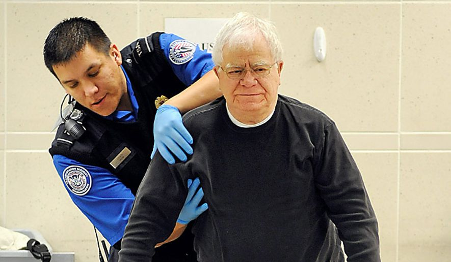 A TSA officer pats down a traveler as he works his way through security at the Minneapolis-St. Paul International Airport in Bloomington, Minn., Wednesday, Nov. 24, 2010.  (AP Photo/Craig Lassig)