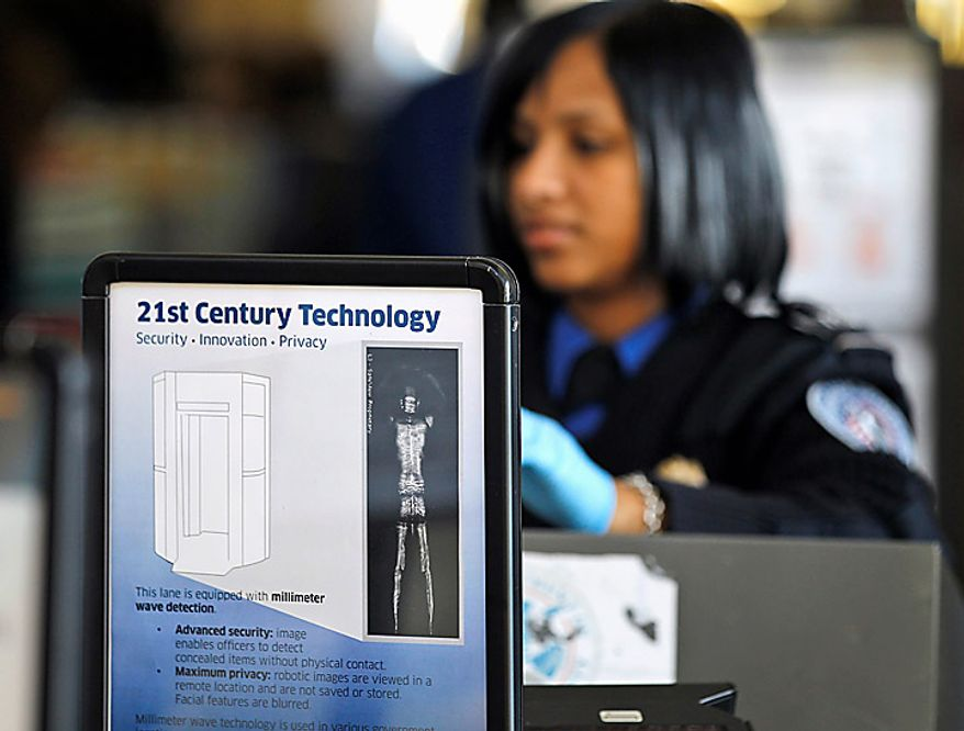 A sign helps explain the new technology to travelers at a TSA security checkpoint at Washington's Ronald Reagan Washington National Airport, Wednesday, Nov. 24, 2010, as the holiday travel season began. (AP Photo/Alex Brandon)