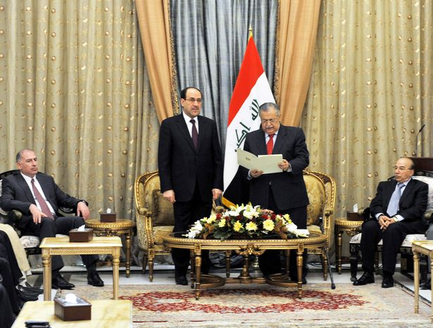 In this photo released by the Iraqi government, Iraqi President Jalal Talabani (second from right) on Thursday formally asks Iraqi Prime Minister Nouri al-Maliki (second from left) to form the next government in Baghdad. Mr. al-Maliki agreed. (Associated Press)