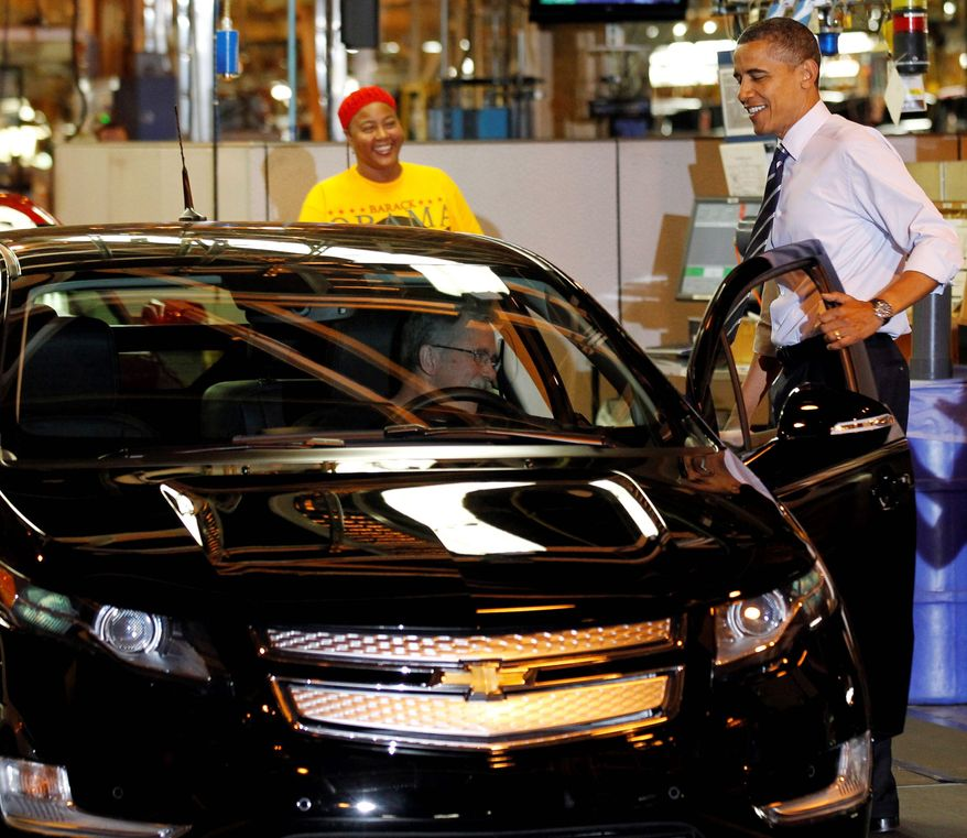 President Obama inspects the new Chevrolet Volt during his tour of the General Motors Auto Plant in Hamtramck, Mich., in July 2010. (Associated Press) **FILE**