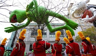 Kermit the Frog and Diary of a Wimpy Kid balloons float in the air before the start of the Macy's Thanksgiving Day Parade in New York Thursday, Nov. 25, 2010. (AP Photo/Craig Ruttle)