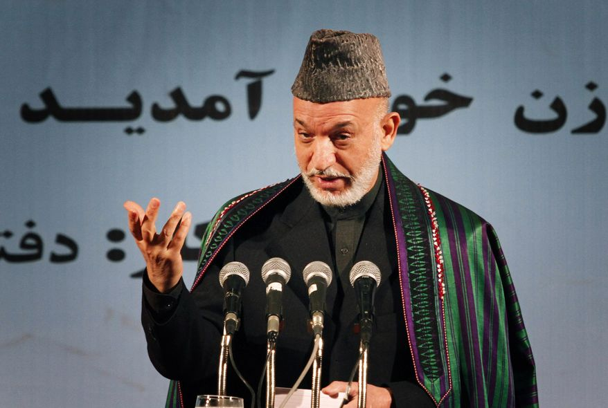 Afghan President Hamid Karzai, during a speech about women's rights, in Kabul, Afghanistan on Wednesday, Nov. 24, 2010. Mr. Karzai said he was happy the results from the Sept. 18 elections were being announced, and called on losing candidates not to take their complaints to the streets but instead to those empowered to deal with them. (AP Photo/Musadeq Sadeq)