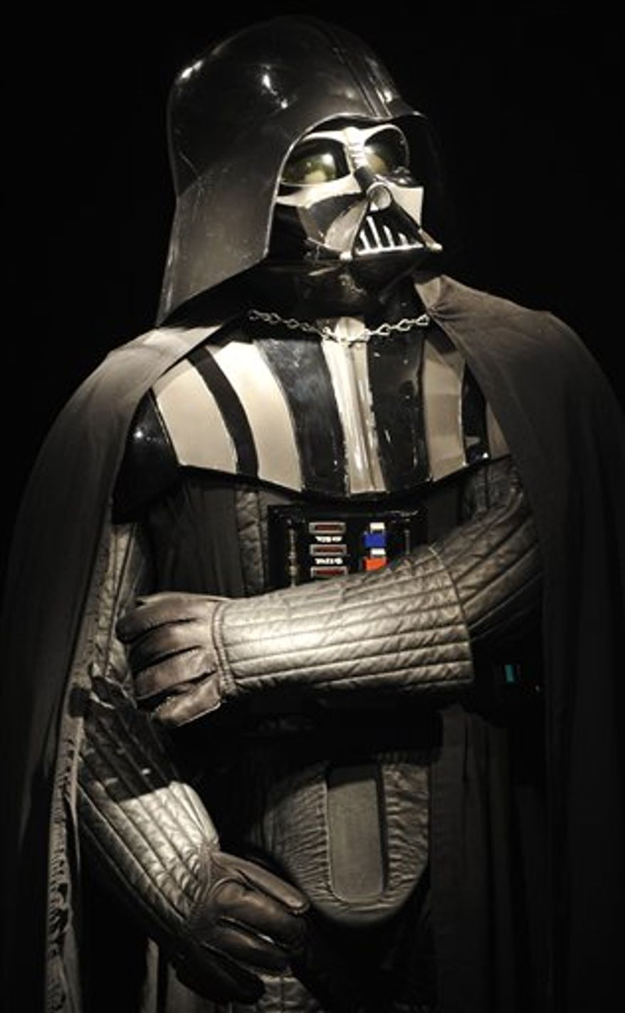 FILE -- An Oct. 27, 2010 file photo shows a Darth Vader costume at Christie's in London.  Christie's says the helmet, mask, shoulder armour and shin guards of the costume had been produced for the second Star Wars movie 'The Empire Strikes Back', released in 1980.  (AP Photo/Lennart Preiss/file)