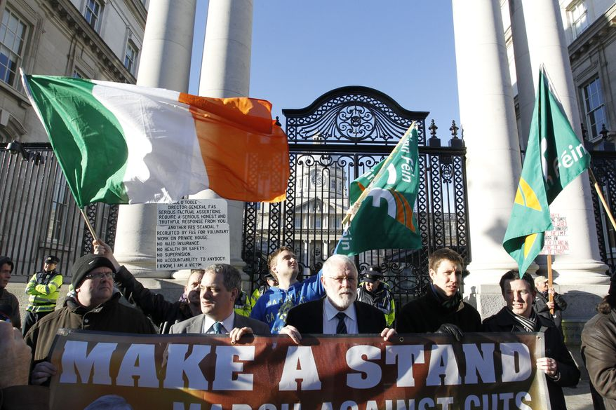 Sinn Fein supporters protest outside Irish government buildings, in Dublin, Ireland, Wednesday, Nov. 24, 2010. The Irish government has unveiled a range of tough austerity measures designed to help solve the country's debt crisis. (AP Photo/Peter Morrison)