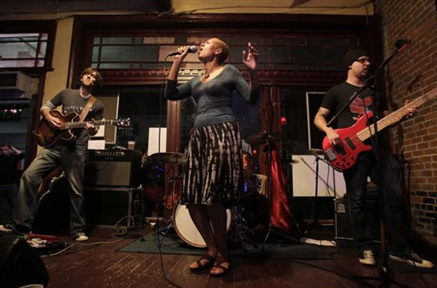 In this Nov. 21, 2010 photo, Margie Perez, right, performs in a music club in New Orleans. More than five years after Hurricane Katrina, New Orleans' music scene remains vibrant and lively, despite the fact that some musicians forced from their homes haven't returned and the doors to many places where they used to entertain remain closed. (AP Photo/Patrick Semansky)