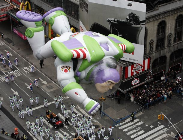 The Buzz Lightyear balloon floats through Times Square during the Macy's Thanksgiving Day parade in New York, Thursday, Nov. 25, 2010. (AP Photo/Jeff Christensen)