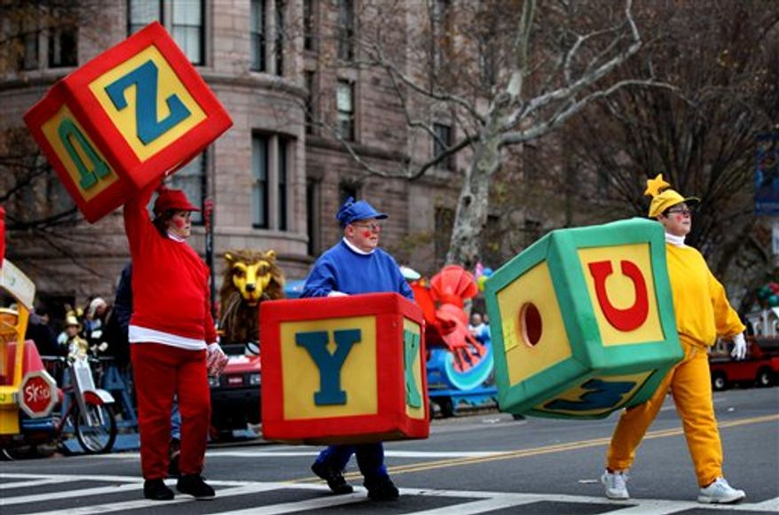 Kylie Monogue rides a float down Central Park West in the Macy's Thanksgiving Day Parade in New York, Thursday, Nov. 25, 2010. (AP Photo/Charles Sykes)