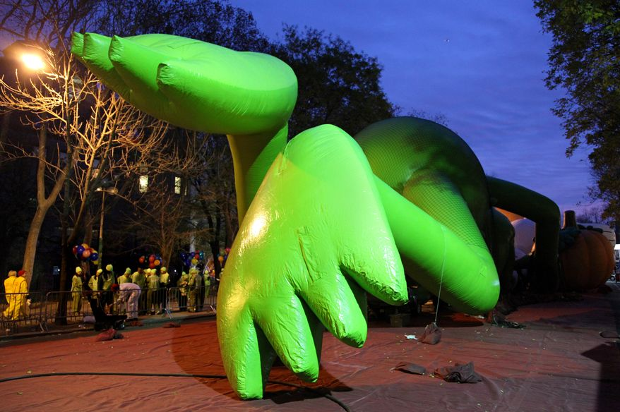 The feet of a Kermit the Frog balloon glow in the work lights before the start of the Macy's Thanksgiving Day Parade in New York Thursday, Nov. 25, 2010. (AP Photo/Craig Ruttle)