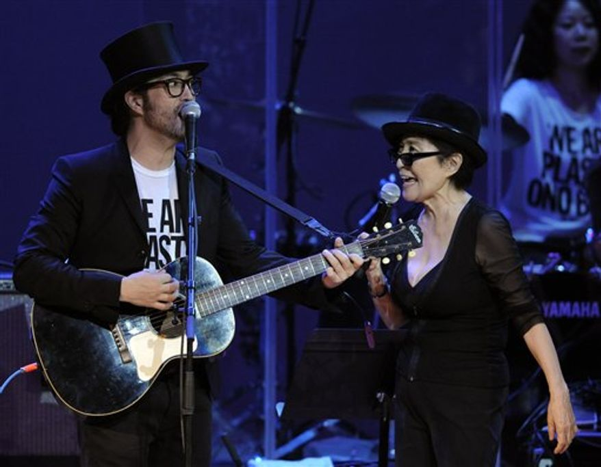"""FILE - In this Oct. 1, 2010 file photo, Yoko Ono, right, performs alongside her son Sean Lennon during the """"Yoko Ono: We Are Plastic Ono Band"""" concert at the Orpheum Theater in Los Angeles. Ono and her son, Sean Lennon, are joining a national oral history project that urges people to take time the day after Thanksgiving for a National Day of Listening with their friends and loved ones. (AP Photo/Chris Pizzello, File)"""
