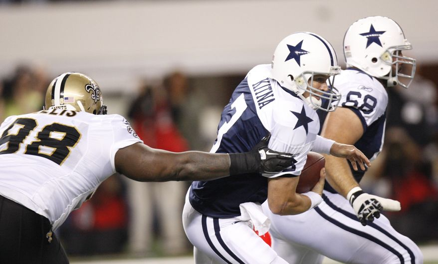 ASSOCIATED PRESS Dallas Cowboys quarterback Jon Kitna (3) tries to evade New Orleans Saints defensive tackle Sedrick Ellis (98) during the first quarter of the NFL football game, Thursday, Nov. 25, 2010, at Cowboys Stadium in Arlington, Texas. Also shown is Cowboys offensive tackle Doug Free (68).