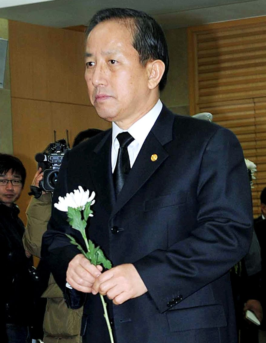South Korean Defense Minister Kim Tae-young prepares to place a flower at the altar during a memorial service for South Korean Marines at a military hospital in Seongnam, South Korea, on Thursday. The Marines were killed in a North Korean artillery barrage on the South Korean border island of Yeonpyeong. Mr. Kim resigned on Thursday, two days after the artillery attack by North Korea killed four people on the small island near the disputed border. (Associated Press)