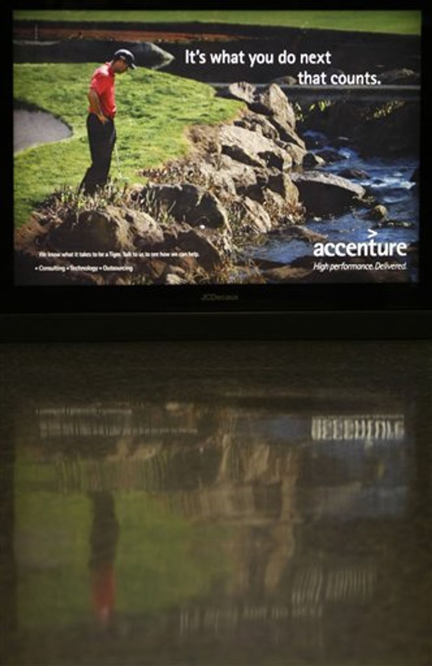 FILE - This Dec. 14, 2009, file photo shows an Accenture ad featuring Tiger Woods at Dulles International Airport in Chantilly, Va.  When Woods ran his SUV over a fire hydrant last Nov. 27, unleashing a torrent of tawdry and shocking details about his infidelities, those clever catch phrases quickly became punchlines. A year has passed since the infamous crash that started it all, and Woods appears ready to re-enter the marketing game.  (AP Photo/Luis M. Alvarez, File)
