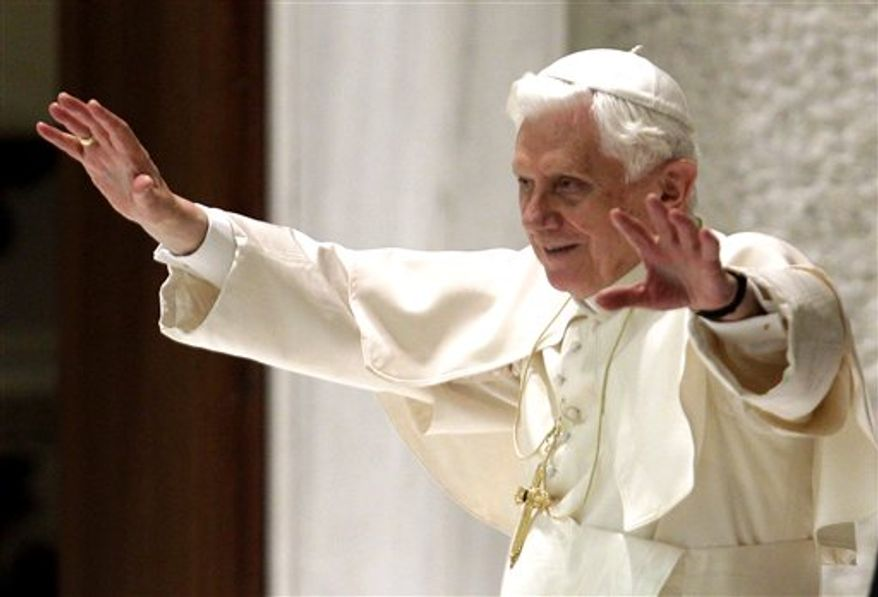 Pope Benedict XVI, right, delivers his message, flanked by Archbishop James Harvey, Prefect of the Papal Household, during his weekly general audience, in Paul VI Hall, at the Vatican, Wednesday, Nov. 24, 2010. (AP Photo/Andrew Medichini)