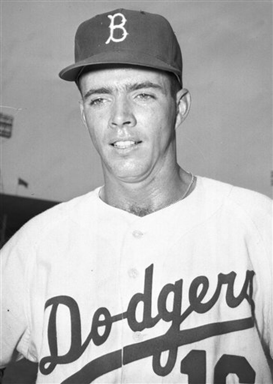 FILE - In this July 4, 1957, file photo, Brooklyn Dodgers pitcher Danny McDevitt poses for a photo at Ebbets Field in New York. McDevitt, the former Dodgers pitcher who won the team's final baseball game at Ebbets Field in 1957, died Saturday, Nov. 20, 2010, of unknown causes his daughter-in-law, Kristie McDevitt said. He was 78. (AP Photo/File)