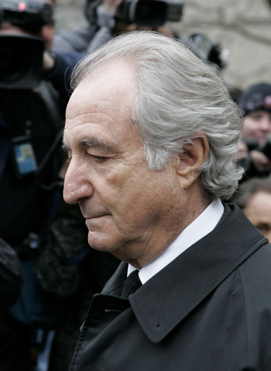 ** FILE ** In this March 10, 2009, file photo, disgraced financier Bernard Madoff exits Manhattan federal court in New York. Relatives of both Madoff and his wife are among those being targeted in 40 lawsuits announced Friday, Nov. 26, 2010, by the trustee endeavoring to recover money for victims fleeced by the disgraced financier. (AP Photo/David Karp, file)