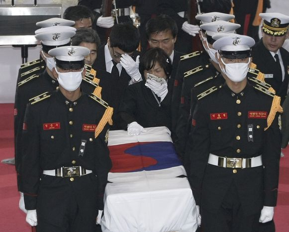 South Korean marines carry a flag-draped casket containing the remains of a marine, killed in Tuesday's North Korean bombardment, during a funeral service at a military hospital in Seongnam, South Korea, on Saturday, Nov. 27, 2010. (AP Photo/Ahn Young-joon)