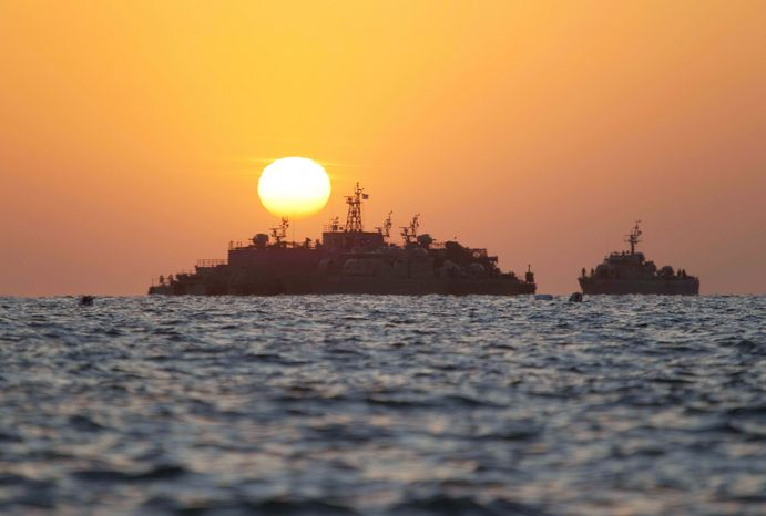 ASSOCIATED PRESS South Korean ships stage off of the coast of South Korea's Yeonpyeong Island on Sunday. The U.S. and South Korea prepared for war games Sunday as South Koreans demanded vengeance.