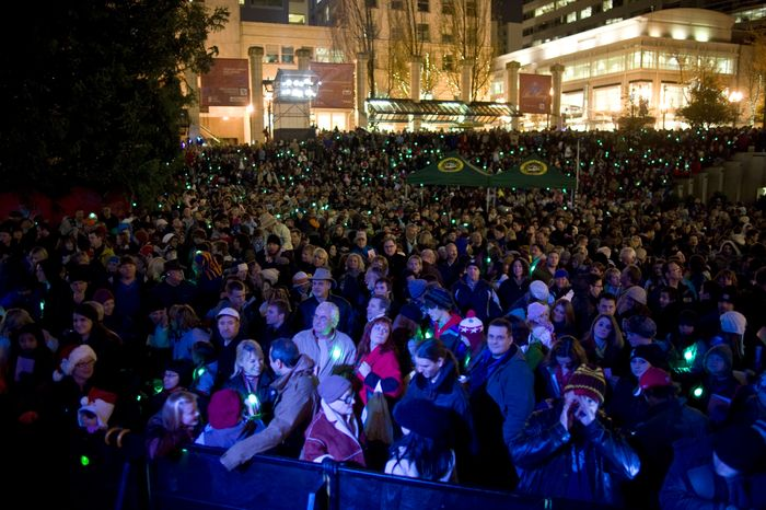 A crowd watches a Christmas-tree-lighting ceremony on Pioneer Courthouse Square on Friday, Nov. 26, 2010, in Portland, Ore. Federal agents in a sting operation arrested a Somali-born teenager just as he tried to blow up a van full of what he believed were explosives at the crowded event, federal authorities said. The bomb was a fake supplied by the agents, and the public was never in danger, authorities said. (AP Photo/The Oregonian, Torsten Kjellstrand)