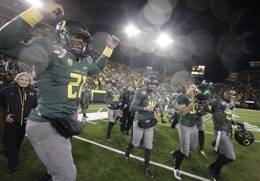 Oregon fans celebrate at the end of game during an NCAA college football game with Arizona, Friday, Nov. 26, 2010, in Eugene, Ore. Oregon defeated Arizona 48-29. (AP Photo/Rick Bowmer)