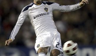 LA Galaxy's David Beckham (23) in action during a match against the Newcastle Jets at EnergyAustralia Stadium in Newcastle, Australia, Saturday, Nov. 27, 2010. (AP Photo/Jeremy Piper)