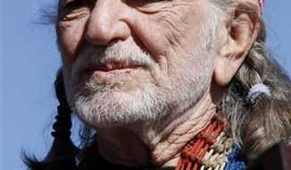 FILE - In this Nov. 7, 2010 photo, Willie Nelson performs before the start of the NASCAR AAA Texas 500 auto race at Texas Motor Speedway, in Fort Worth, Texas. A U.S. Border Patrol spokesman says Nelson was charged with marijuana possession after 6 ounces was found aboard his tour bus, Friday, Nov. 26, 2010, in Sierra Blanca, Texas. (AP Photo/Tim Sharp, File)
