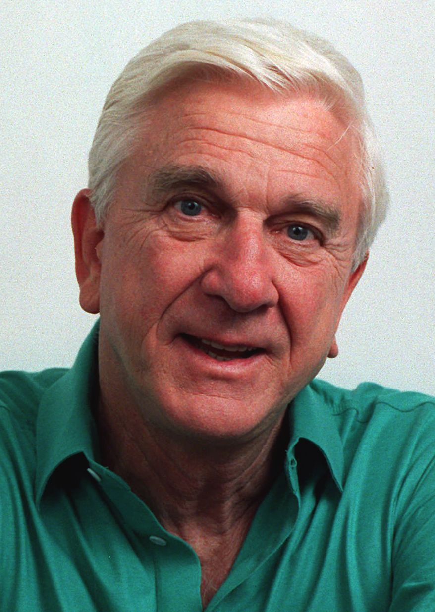 """FILE - This file photo taken in November 1991, shows actor Leslie Nielsen. The Canadian-born Nielsen, who went from drama to inspired bumbling as a hapless doctor in """"Airplane!"""" and the accident-prone detective Frank Drebin in """"The Naked Gun"""" comedies, has died. He was 84. His agent John S. Kelly says Nielsen died Sunday, Nov. 28, 2010, at a hospital near his home in Ft. Lauderdale, Fla., where he was being treated for pneumonia. (AP Photo/Doug Pizac, file)"""