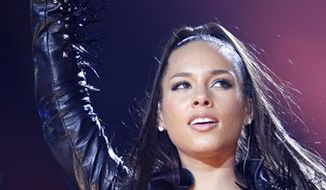 FILE - In this May 9, 2010 file photo, U.S. singer Alicia Keys performs on stage at the Festhalle in Frankfurt am Main, Germany. (AP Photo/Mario Vedder, file)