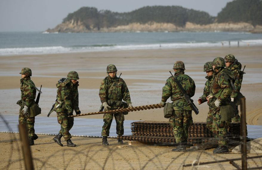 South Korean soldiers take part in a military drill on scenic Mallipo Beach in western South Korea on Sunday, Nov. 28, 2010. (AP Photo/Wally Santana)