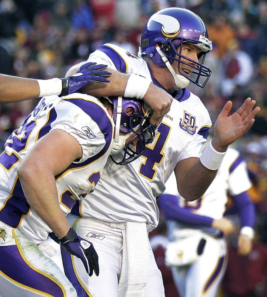Minnesota Vikings quarterback Brett Favre (4) celebrates running back Toby Gerhart's touchdown during the second half of an NFL football game against the Washington Redskins in Landover, Md., Sunday, Nov. 28, 2010. (AP Photo/Pablo Martinez Monsivias)