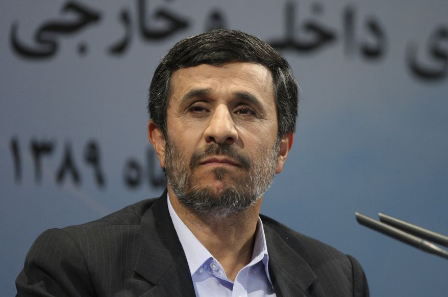 ** FILE ** Iranian President Mahmoud Ahmadinejad listens to a question during a press conference in Tehran on Monday, Nov. 29, 2010. (AP Photo/Vahid Salemi)