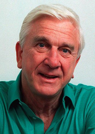 """This file photo taken in November 1991, shows actor Leslie Nielsen. The Canadian-born Nielsen, who went from drama to inspired bumbling as a hapless doctor in """"Airplane!"""" and the accident-prone detective Frank Drebin in """"The Naked Gun"""" comedies, has died. He was 84. His agent John S. Kelly says Nielsen died Sunday, Nov. 28, 2010, at a hospital near his home in Ft. Lauderdale, Fla., where he was being treated for pneumonia. (AP Photo/Doug Pizac, file)"""