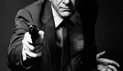 """This 1988 file photo provided by Paramount, shows actor Leslie Nielsen as Lt. Frank Drebin in the movie """"The Naked Gun: From the Files of Police Squad!"""" The Canadian-born Nielsen, who went from drama to inspired bumbling as a hapless doctor in """"Airplane!"""" and the accident-prone detective Frank Drebin in """"The Naked Gun"""" comedies, has died. He was 84. His agent John S. Kelly said the actor died Sunday, Nov. 28, 2010, at a hospital near his home in Florida where he was being treated for pneumonia. (AP Photo/Paramount, File)"""