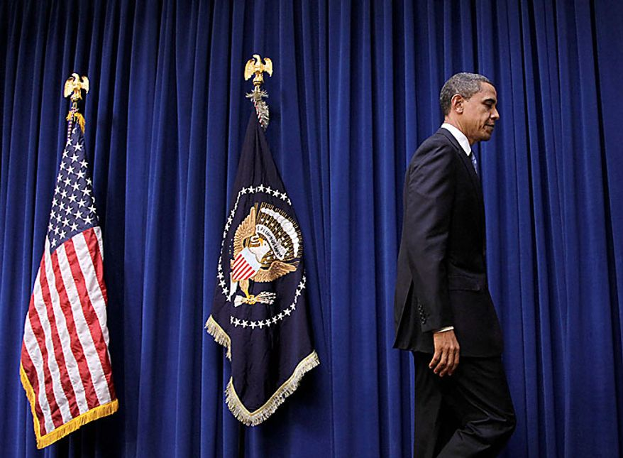 President Barack Obama leaves after delivering a statement in the in the Old Executive Office Building on the White House campus in Washington, Monday, Nov. 29, 2010.  (AP Photo/Pablo Martinez Monsivais)