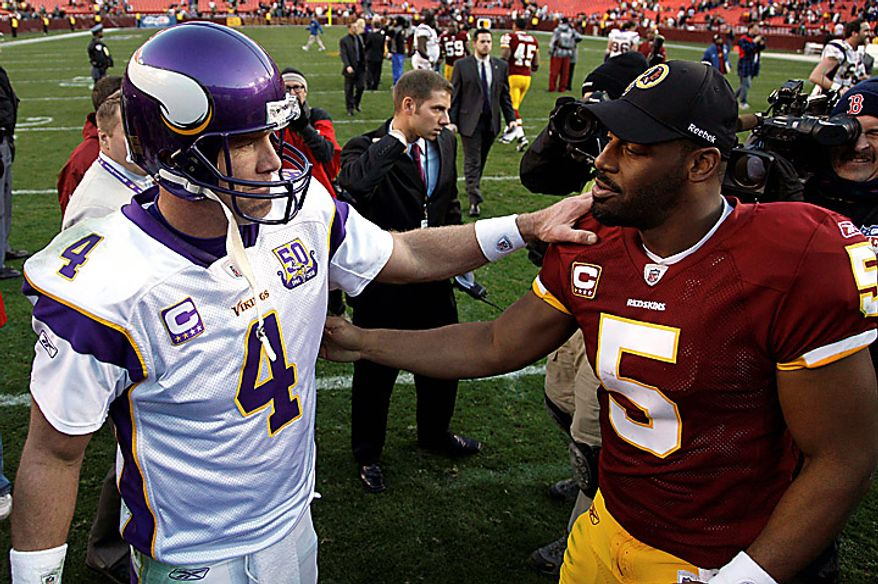 Minnesota Vikings quarterback Brett Favre (4) greets Washington Redskins quarterback Donovan McNabb (5) after an NFL football game in Landover, Md., Sunday, Nov. 28, 2010. The Vikings won 17-13. (AP Photo/Evan Vucci)