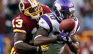 Safety Madieu Williams, shown with the Minnesota Vikings in 2010, breaks up a pass intended for Washington Redskins wide receiver Anthony Armstrong. Williams agreed to a one-year deal with the Redskins on Monday. (AP Photo/Evan Vucci)