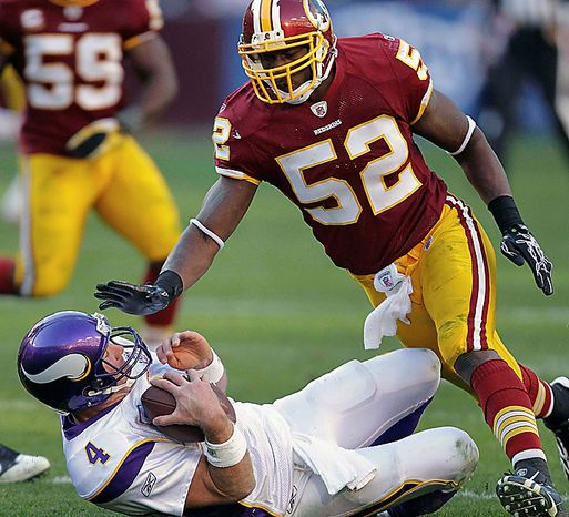**FILE** Washington Redskins linebacker Rocky McIntosh (52) reaches for Minnesota Vikings quarterback Brett Favre after Farve hit the turf after a short carry during the second half of the Vikings' 17-13 victory in Landover, Md., on Nov. 28, 2010. (Associated Press)