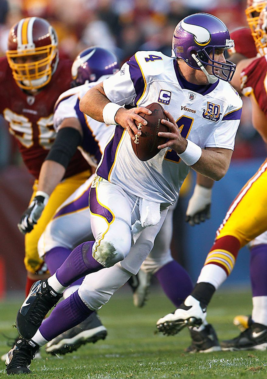 Minnesota Vikings quarterback Brett Favre scrambles with the ball during the second half of an NFL football game against the Washington Redskins in Landover, Md., Sunday, Nov. 28, 2010. The Vikings defeated the Redskins 17-13. (AP Photo/Evan Vucci)