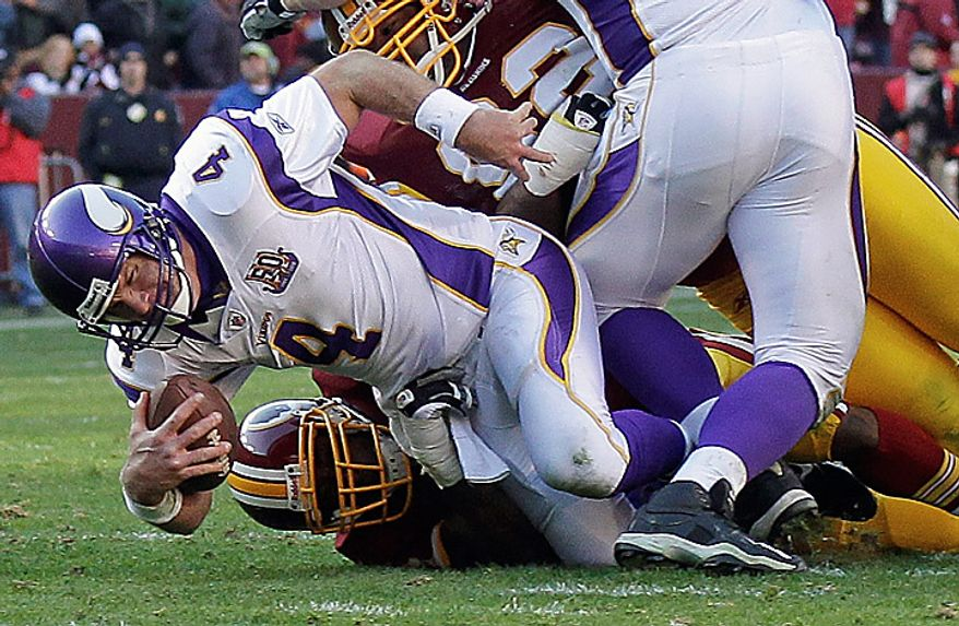 Minnesota Vikings quarterback Brett Favre (4) is sacked by Washington Redskins linebacker Andre Carter during the second half of an NFL football game in Landover, Md., Sunday, Nov. 28, 2010. (AP Photo/Pablo Martinez Monsivias)