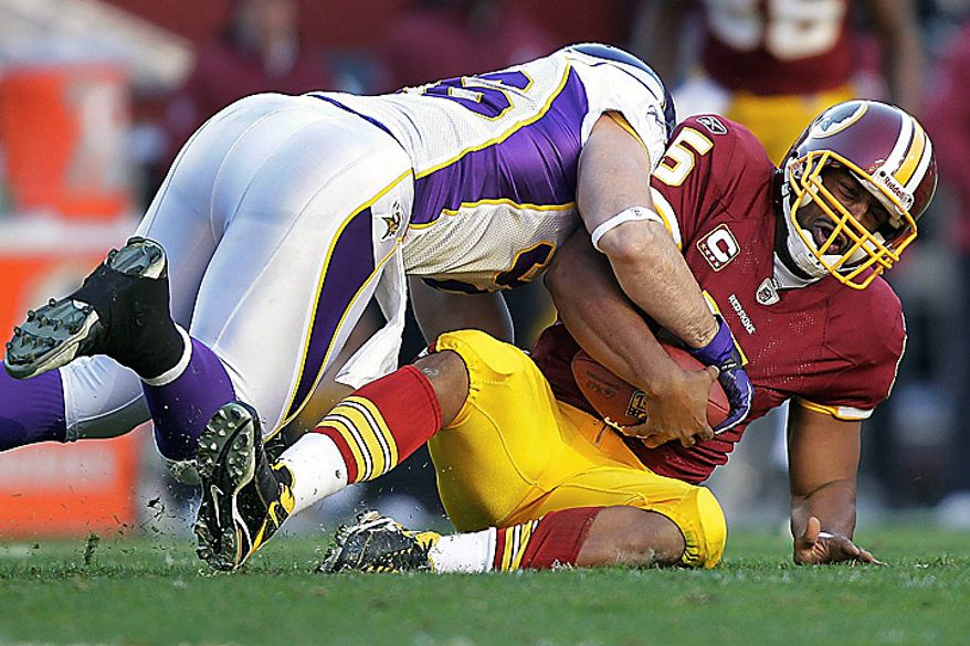 Washington Redskins quarterback Donovan McNabb (5) is sacked by Minnesota Vikings defensive end Brian Robison during the second half of an NFL football game in Landover, Md., Sunday, Nov. 28, 2010. The Vikings defeated the Redskins 17-13. (AP Photo/Pablo Martinez Monsivais)