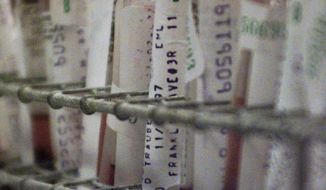 ** FILE ** Blood vials await examination for the AIDS virus at Brooklyn's Interfaith Medical Center on Wednesday, Nov. 26, 1997, in New York. (AP Photo/Adam Nadel)