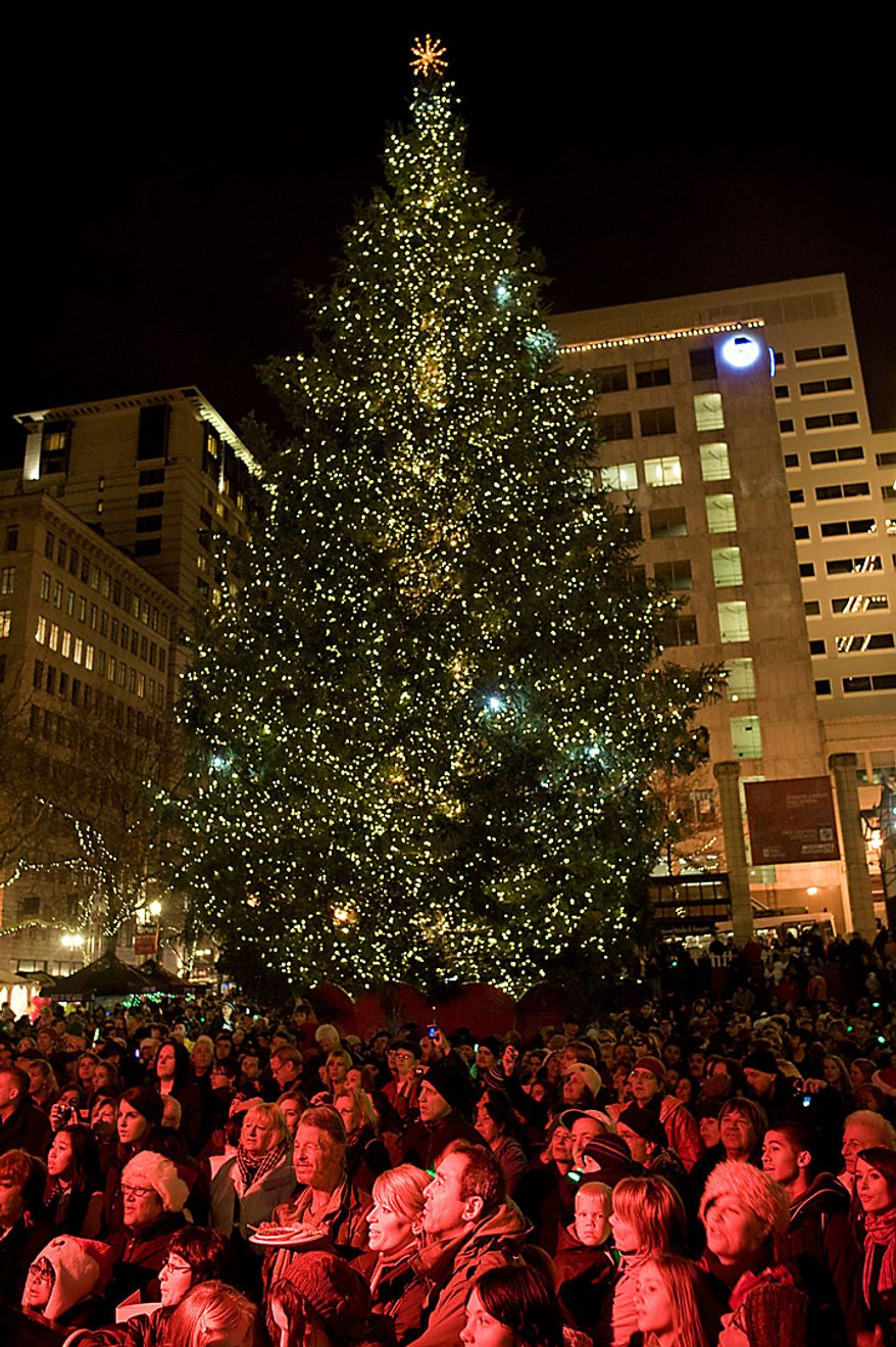 The tree is lit on Pioneer Courthouse square Friday night Nov. 26, 2010 to the music of Pink Martini and with Santa Claus in front of a shoulder-to-shoulder crowd singing holiday music in the square. A Somali-born teenager, Mohamed Osman Mohamud, 19, was arrested at 5:40 p.m. just after he dialed a cell phone that he thought would blow up a van laden with explosives but instead brought federal agents and Portland police swooping in to take him into custody, federal prosecutors said.  He was charged with attempted use of a weapon of mass destruction. (AP Photo/Torsten Kjellstrand - The Oregonian)