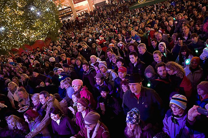 The crowd watches as the tree is lit on Pioneer Courthouse square Friday night, Nov. 26, 2010 to the music of Pink Martini and with Santa Claus. A Somali-born teenager, Mohamed Osman Mohamud, 19, was arrested at 5:40 p.m. just after he dialed a cell phone that he thought would blow up a van laden with explosives but instead brought federal agents and Portland police swooping in to take him into custody. He was arrested and charged with attempted use of a weapon of mass destruction. He's scheduled for a court appearance Monday.  (AP Photo/Torsten Kjellstrand - The Oregonian)