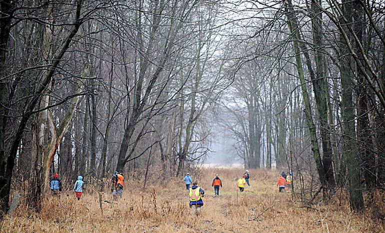 "Volunteers and rescuers search for 9-year-old Andrew, 7-year-old Alexander and 5-year-old Tanner Skelton in Morenci, Mich. on Tuesday, Nov. 30, 2010. Authorities ""do not anticipate a positive outcome"" in the search for three Michigan brothers who have been missing since their father's attempted suicide, a police chief said Tuesday. (AP Photo/The Detroit News, David Coates)"