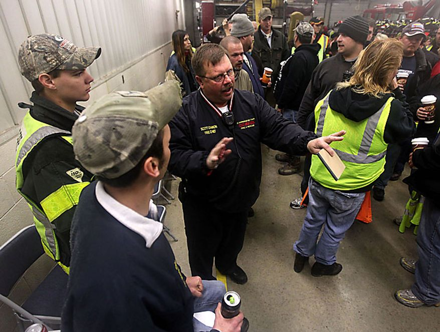 """Chief Scott Damon, of Cambridge Township Fire Department organizes a search party at the Morenci fire department in Morency, Mich, for 9-year-old Andrew, 7-year-old Alexander and 5-year-old Tanner Skelton Tuesday, Nov. 30, 2010. Authorities """"do not anticipate a positive outcome"""" in the search for three Michigan brothers who have been missing since their father's attempted suicide, a police chief said Tuesday. (AP Photo/Detroit Free Press, Andre J. Jackson)"""